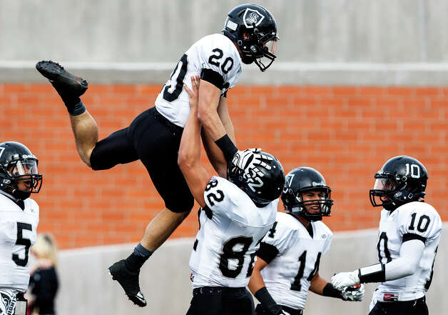 Steele's Matthew Moen hoists Matthew Mayle in the air following Mayle's 52-yard touchdown during the first quarter of their Class 5A Division II second round playoff game with Roosevelt at Heroes Stadium on Nov. 23, 2012.  Steele  won the game 45-0.  MARVIN PFEIFFER/ mpfeiffer@express-news.net Photo: MARVIN PFEIFFER, Express-News / Express-News 2012
