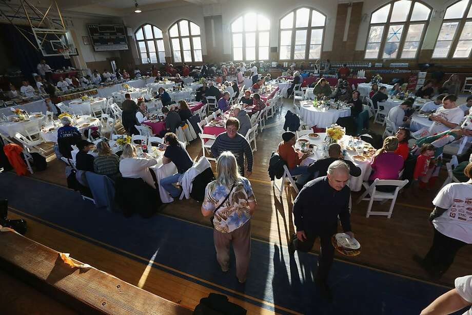 Residents gather for a free Thanksgiving dinner at St. Francis de Sales Parish. Photo: Mario Tama, Getty Images
