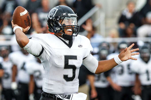 Steele quarterback Breylann McCollum prepares to throw his third touchdown pass of the game to Matthew Mayle during the second quarter of their Class 5A Division II second round playoff game at Heroes Stadium on Nov. 23, 2012.  Steele won the game 45-0.  MARVIN PFEIFFER/ mpfeiffer@express-news.net Photo: MARVIN PFEIFFER, Express-News / Express-News 2012