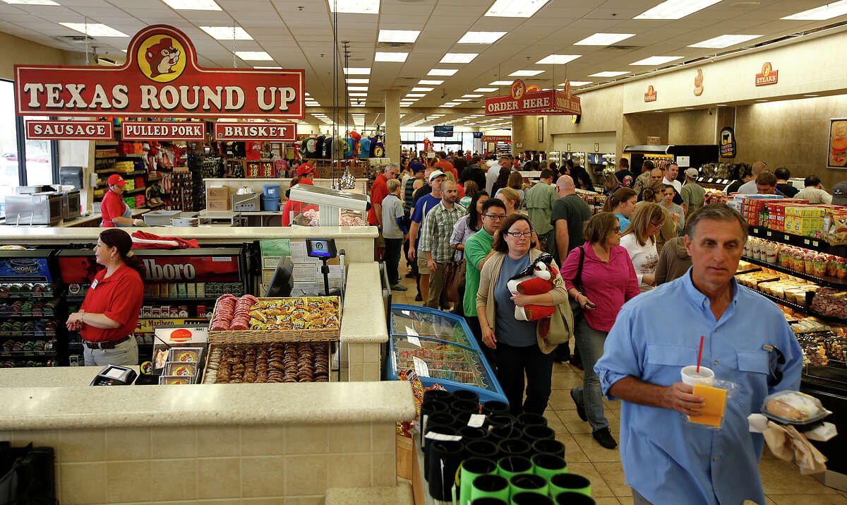 Shoppers browse the selection during Black Friday at Buc-ee's in Luling on Friday, Nov. 23, 2012.