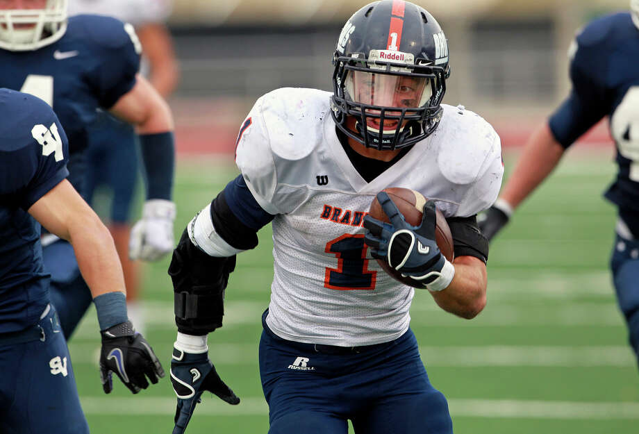 Trinton Ynclan gains yards as Brandeis beats Smithson Valley 28-20 at Camalander Stadium in second round playoff action on November 23, 2012. Photo: Tom Reel, Express-News / ©2012 San Antono Express-News