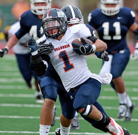Trinton Ynclan rolls for the Broncos as Brandeis beats Smithson Valley 28-20 at Camalander Stadium in second round playoff action on November 23, 2012. Photo: Tom Reel, Express-News / ©2012 San Antono Express-News