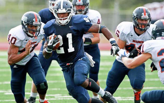 Lawrence Mattison gains yards as Brandeis beats Smithson Valley 28-20 at Camalander Stadium in second round playoff action on November 23, 2012. Photo: Tom Reel, Express-News / ©2012 San Antono Express-News