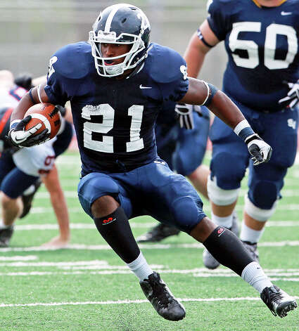 Lawrence Mattison shifts directions for the Rangers as Brandeis beats Smithson Valley 28-20 at Camalander Stadium in second round playoff action on November 23, 2012. Photo: Tom Reel, Express-News / ©2012 San Antono Express-News