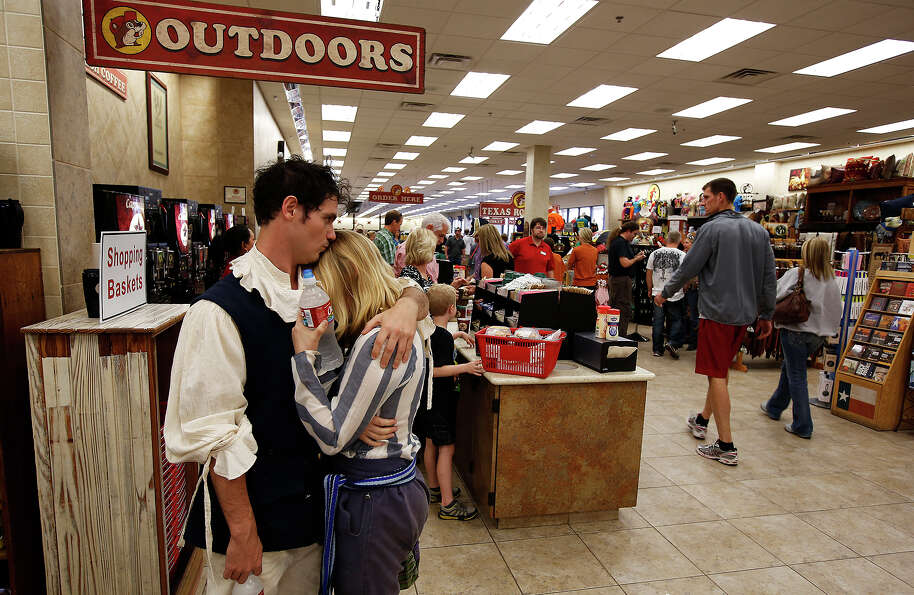 James Mariano, left, and Tara Luck share a moment at Buc-ee's on their way to a renaissance festival