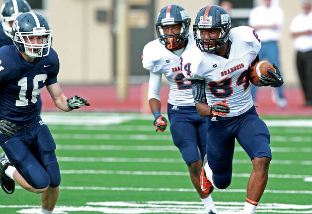 Bronco receiver Larry Stephens picks up yards on the left as Brandeis beats Smithson Valley 28-20 at Camalander Stadium in second round playoff action on November 23, 2012. Photo: Tom Reel, Express-News / ©2012 San Antono Express-News