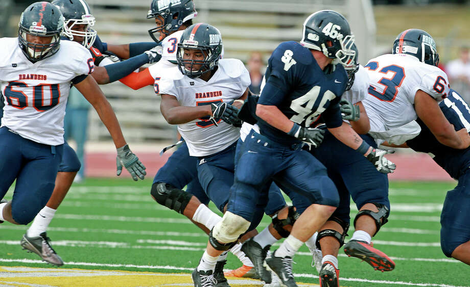 Faissal Shabani gets through a hole as Brandeis beats Smithson Valley 28-20 at Camalander Stadium in second round playoff action on November 23, 2012. Photo: Tom Reel, Express-News / ©2012 San Antono Express-News