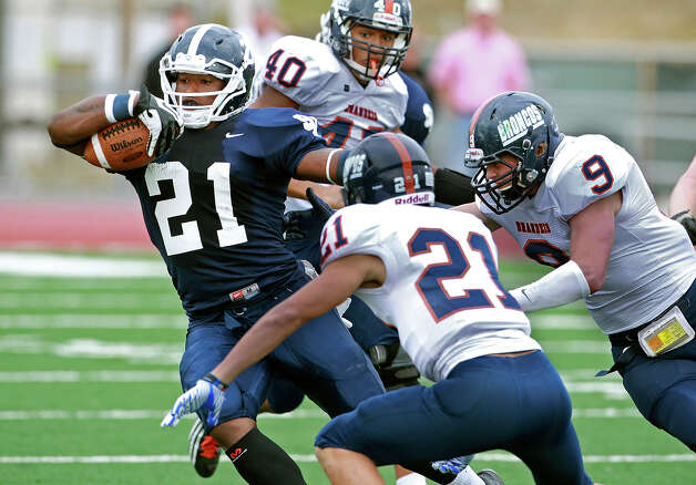 Ranger running back Lawrence Mattison tries to slide away from Bronco tacklers as Brandeis beats Smithson Valley 28-20 at Camalander Stadium in second round playoff action on November 23, 2012. Photo: Tom Reel, Express-News / ©2012 San Antono Express-News