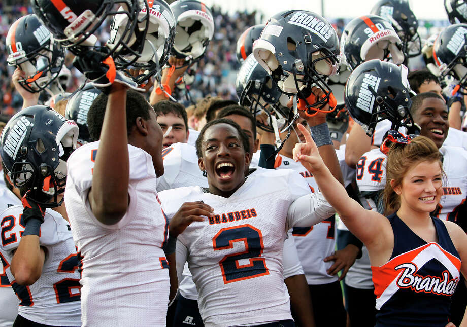 Bronco players Faissal Shabani (5) and Kadarius Lee (2) celebrate as Brandeis beats Smithson Valley 28-20 at Camalander Stadium in second round playoff action on November 23, 2012. Photo: Tom Reel, Express-News / ©2012 San Antono Express-News
