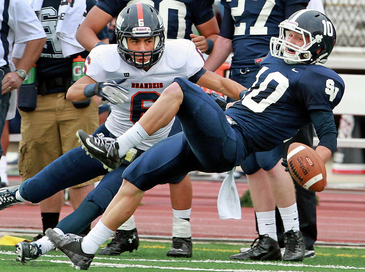 Ranger receiver Taylor West gets knocked away from the ball and a reception by Bronco safety Alec Sifuentes as Brandeis beats Smithson Valley 28-20 at Camalander Stadium in second round playoff action on November 23, 2012.