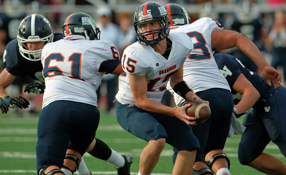Bronco quarterback Colbie Price turns with a pitch to his running back as Brandeis beats Smithson Valley 28-20 at Camalander Stadium in second round playoff action on November 23, 2012. Photo: Tom Reel, Express-News / ©2012 San Antono Express-News