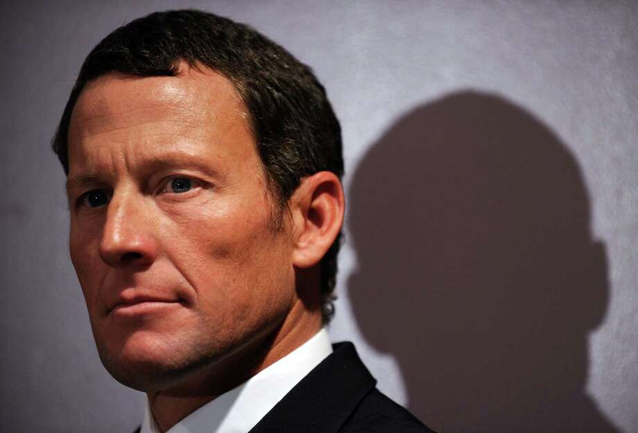 "(FILES) -- A file photo taken on February 28, 2011 photo shows seven-time Tour de France winner Lance Armstrong attending a press conference in Los Angeles to annunce he will serve as co-chair for the campaign seeking to raise more than 600 million USD annually for cancer research in California. Armstrong must pay back all his winnings following the decision to rescind all his results since August 1, 1998, in the wake of a doping scandal, world cycling chiefs said on October 26, 2012. The International Cycling Union (UCI) ""called on Armstrong and all other affected riders to return the prize money they had received"".       AFP PHOTO / Gabriel BOUYSGABRIEL BOUYS/AFP/Getty Images Photo: GABRIEL BOUYS, Staff / AFP"