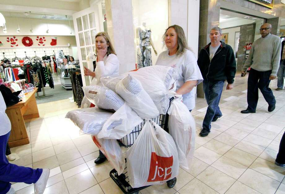 Laura Whitty of Harrisville, Miss., left, and Janice Barnett of Jayess, Miss. push a shopping cart through Northpark Mall in Ridgeland, Miss., Friday, Nov. 23, 2012.  Black Friday, the day when retailers traditionally turn a profit for the year, got a jump start this year as many stores opened just as families were finishing up Thanksgiving dinner. (AP Photo/Rogelio V. Solis) Photo: Rogelio V. Solis