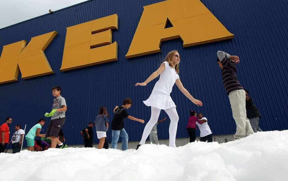 Children play in a mound of snow as IKEA Houston hosted a Swedish-inspired holiday experience complete with real snow, free breakfast, live reindeer and a visit from Jultomten, Sweden's Santa Claus Friday, Nov. 23, 2012, in Houston. Photo: Johnny Hanson, Houston Chronicle / © 2012  Houston Chronicle