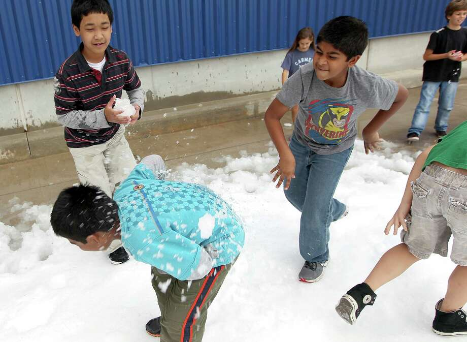 Sohan Pavan, 6, center, is hit with a snowball by his brother, Pavan Kureti, 10, next to Dwee Utama, 12, as IKEA Houston hosted a Swedish-inspired holiday experience complete with real snow in front of the store, free breakfast, live reindeer and a visit from Jultomten, his wife and elves Friday, Nov. 23, 2012, in Houston. Photo: Johnny Hanson, Houston Chronicle / © 2012  Houston Chronicle