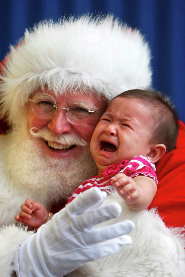 Celeste Escoto, 6 months old, didn't care for her first visit with Jultomten, Sweden's Santa Claus, as IKEA Houston hosted a Swedish-inspired holiday experience complete with real snow, free breakfast, live reindeer and a visit from Jultomten, his wife and elves Friday, Nov. 23, 2012, in Houston. Photo: Johnny Hanson, Houston Chronicle / © 2012  Houston Chronicle