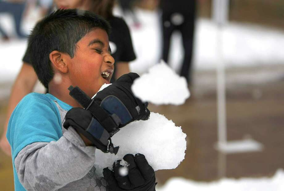 """Sohan Pavan, 6, is hit with a snowball by his brother, as IKEA Houston hosted a Swedish-inspired holiday experience complete with real snow in front of the store, free breakfast, live reindeer and a visit from Jultomten, his wife and elves Friday, Nov. 23, 2012, in Houston.  The store called the day """"Blue Friday,"""" to capture a different approach to the busiest shopping day of the year. Photo: Johnny Hanson, Houston Chronicle / © 2012  Houston Chronicle"""