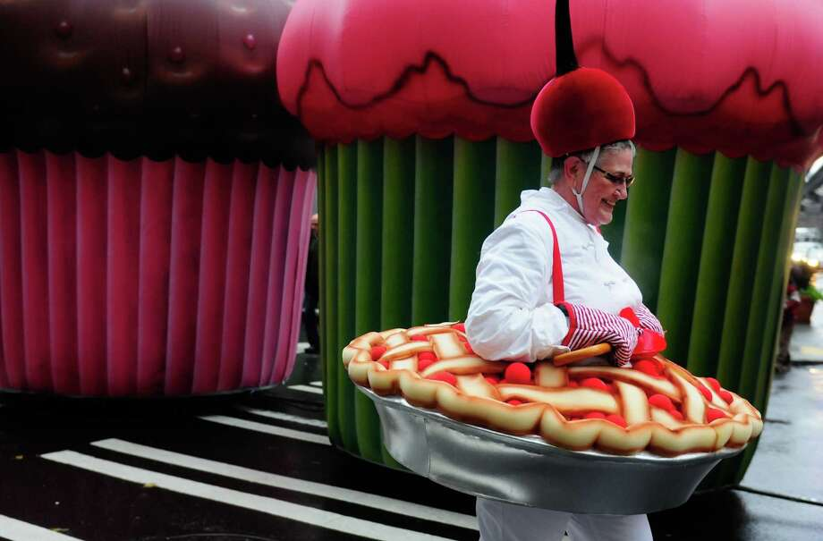 Dressed as a cherry pie, Jeanne McNeil smiles as she walks. Photo: LINDSEY WASSON / SEATTLEPI.COM