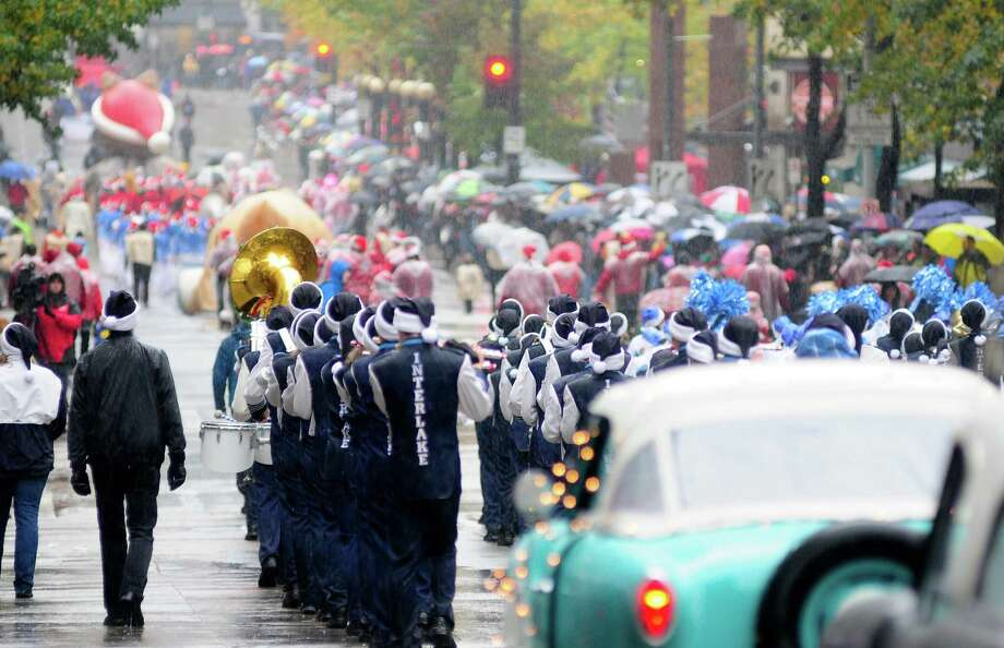Parade participants march in the rain. Photo: LINDSEY WASSON / SEATTLEPI.COM