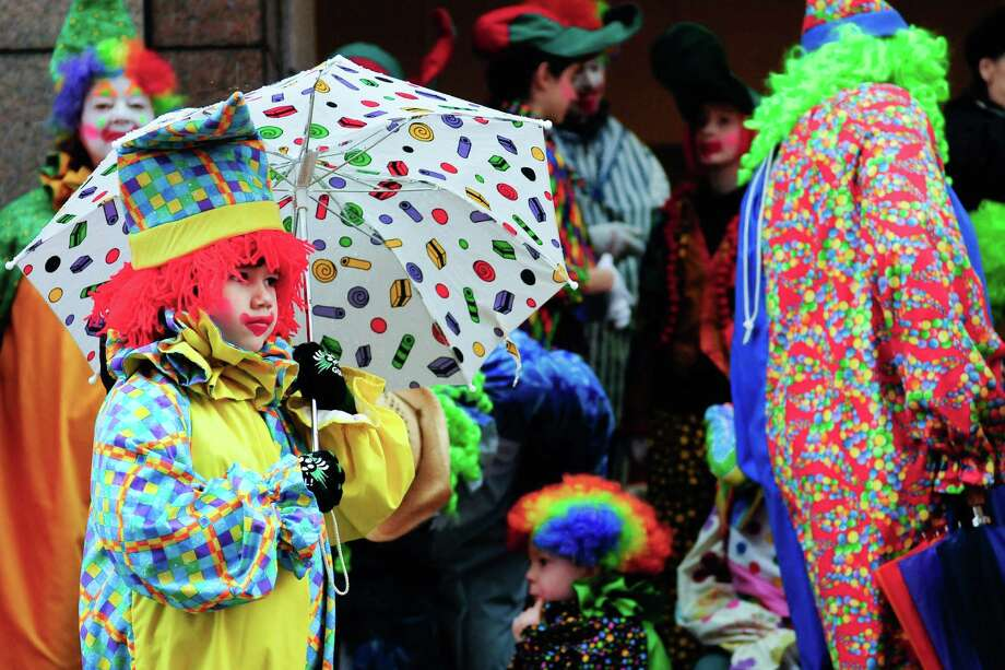Spencer Doxsee, 5, waits under an umbrella with a host of other colorful clowns as they wait to join the parade. Photo: LINDSEY WASSON / SEATTLEPI.COM
