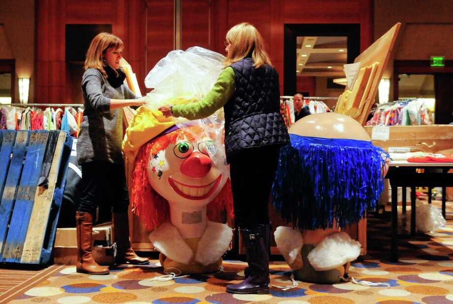 Sunny Jelenffy and her mother, Gayle Albert, put away large costumes at the Grand Hyatt Seattle after the Macy's Holiday Parade. Photo: LINDSEY WASSON / SEATTLEPI.COM