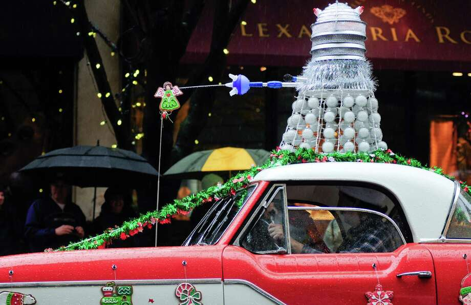 A Dalek from Dr. Who sits atop an old car. Photo: LINDSEY WASSON / SEATTLEPI.COM