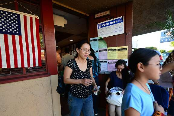Asian Americans vote on Election Day at a Denny's Restaurant in Temple City, Los Angeles County, on November 6, 2012 in California, as Americans flock to the polls nationwide to decide between President Barack Obama, his Rebuplican challenger Mitt Romney, and a wide range of other issues. Temple City is one of six cities in California's 49th Assembly District, the state's first legislative district where Asian-Americans make up the majority of the population.    AFP PHOTO/Frederic J. BROWNFREDERIC J. BROWN/AFP/Getty Images