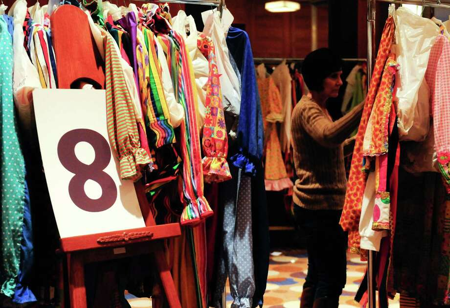 Deana Schenk, a hired worker from Quality Dressers, sorts costumes in the Grand Hyatt Seattle after the Macy's Holiday Parade. Photo: LINDSEY WASSON / SEATTLEPI.COM