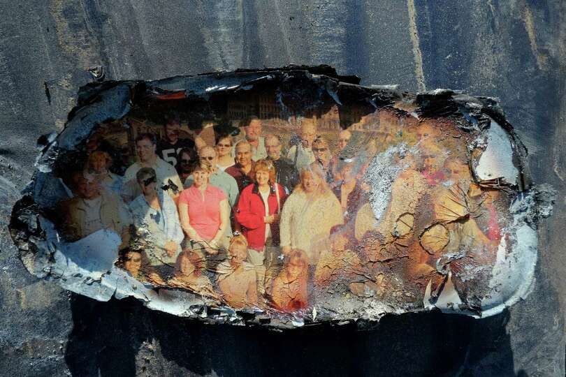 A fire and flood-damaged photo is displayed after it was salvaged by Deirdre Mathis McGovern, from t