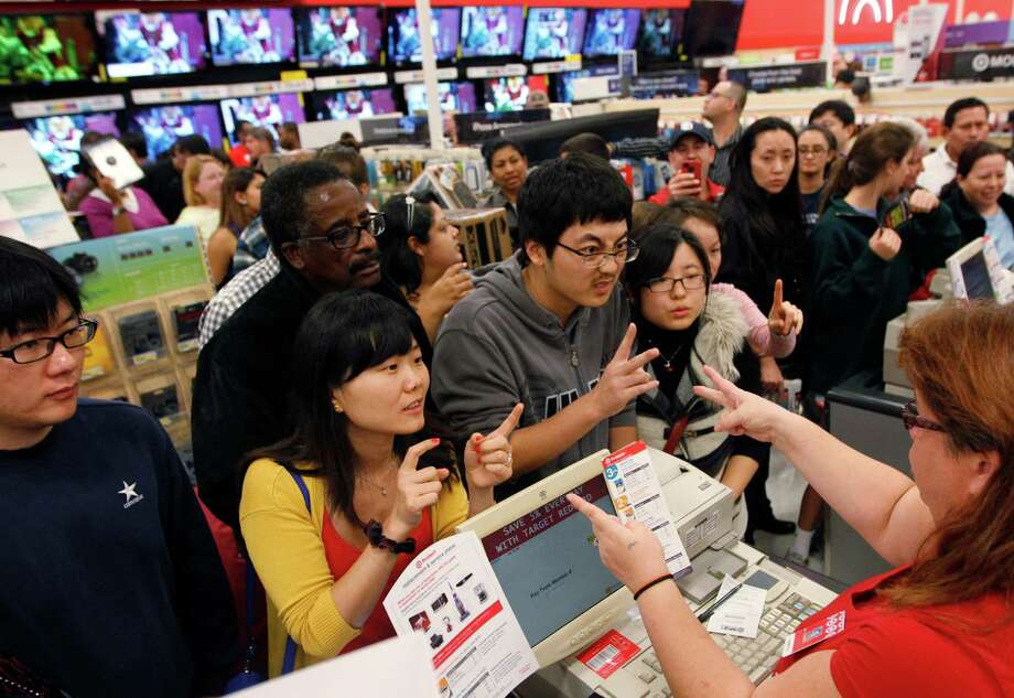 Eager customers congregate at the electronics counter at a Target in Houston for early Black Friday deals on Thursday. Observers say large flat-screen televisions were among the major movers at the event. Photo: Mayra Beltran, Staff / © 2012 Houston Chronicle