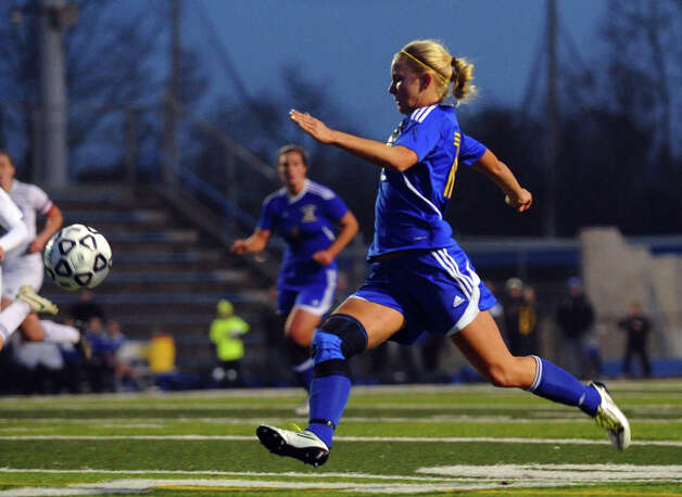 Newtown #15 Amy Martin chases down the ball, Class LL girls soccer championship action against Glastonbury in West Haven, Conn. on Friday November 23, 2012. Photo: Christian Abraham