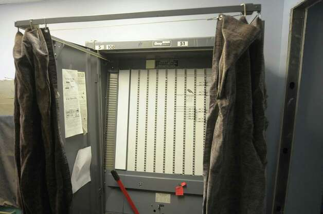 An old mechanical lever voting machine at the Albany County Board of Elections on Monday, Nov. 19, 2012 in Albany, NY. (Paul Buckowski / Times Union) Photo: Paul Buckowski