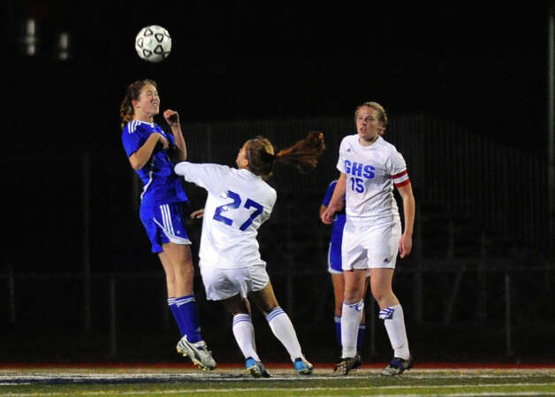 Newtown #5 Madeline Sieber heads the ball, Class LL girls soccer championship action against Glastonbury in West Haven, Conn. on Friday November 23, 2012. Photo: Christian Abraham