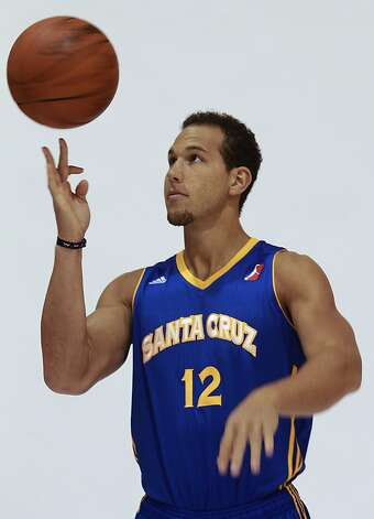 Taylor Griffin twirls a basketball during a photo shoot at media day for the Santa Cruz Warriors in Oakland, Calif. on Thursday, Nov. 15, 2012. Griffin's brother Blake Griffin is an all-star for the NBA's Los Angeles Clippers. Photo: Paul Chinn, The Chronicle