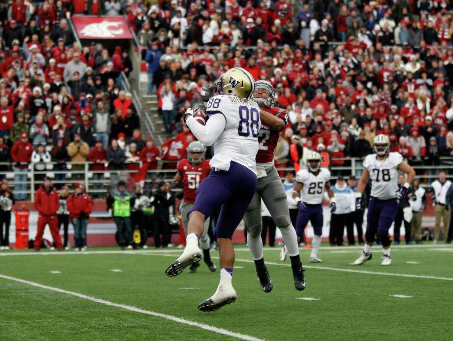 Tight end Austin-Seferian Jenkins #88 of the Washington Huskies scores a touchdown putting the Huskies on the board early in the second quarter during the game against the Washington State Cougars. Photo: William Mancebo, Getty Images / 2012 William Mancebo