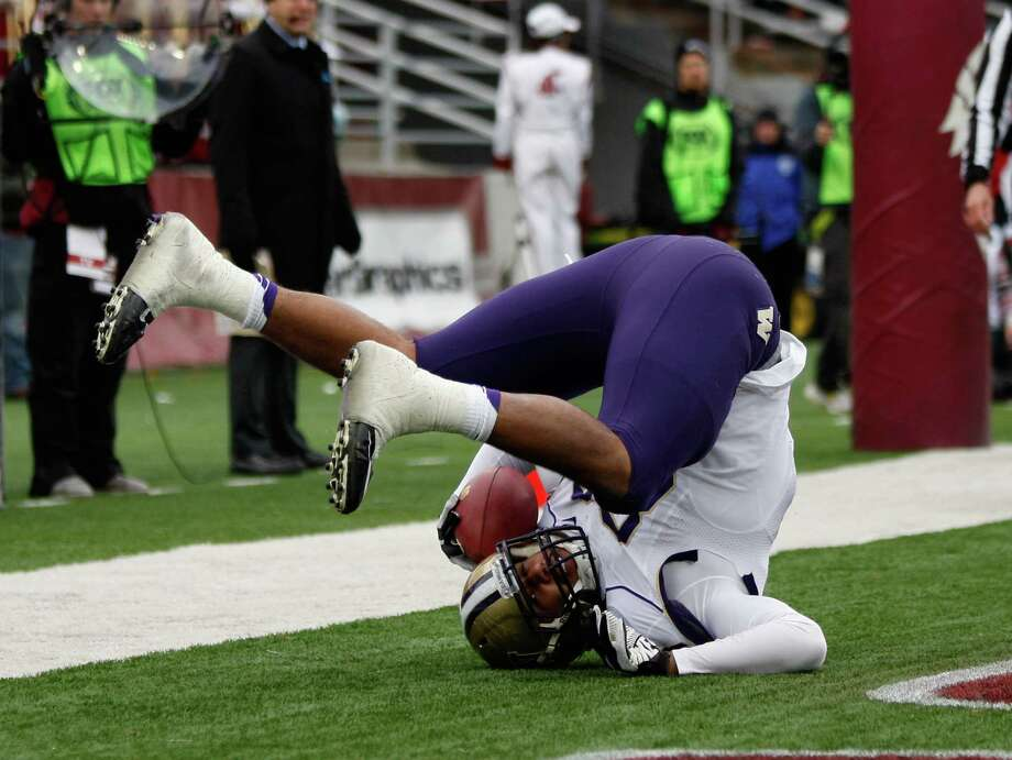 Tight end Austin-Seferian Jenkins #88 of the Washington Huskies reacts after scoring a touchdown that put the Huskies on the board early in the second quarter during the game against the Washington State Cougars. Photo: William Mancebo, Getty Images / 2012 William Mancebo