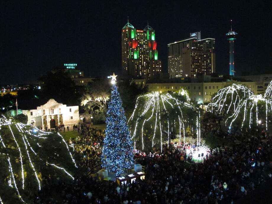 People gather at Alamo Plaza for the 28th Annual H-E-B Tree Lighting Ceremony on Friday, Nov. 23, 2012. The 55-foot tall fir tree was lit with 10,000 LED lights and with 450 ornaments. The event kicked off the holiday season followed by the 30th Annual Ford Holiday River Parade along the San Antonio River. Photo: Benjamin Olivo, San Antonio Express-News