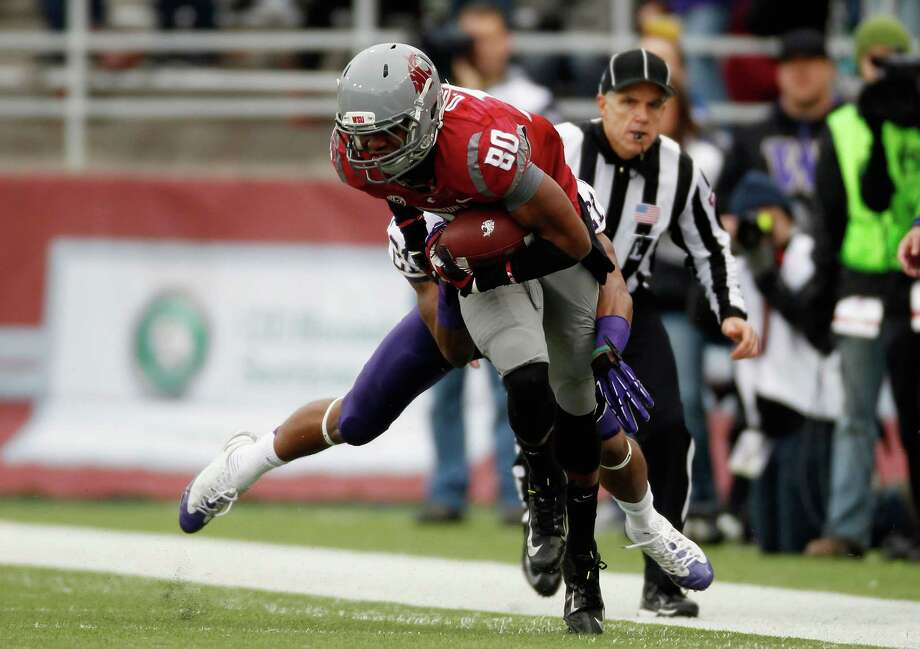 Wide receiver Dominique Williams #80 of the Washington State Cougars is tackled while during a game against the Washington Huskies. Photo: William Mancebo, Getty Images / 2012 Getty Images