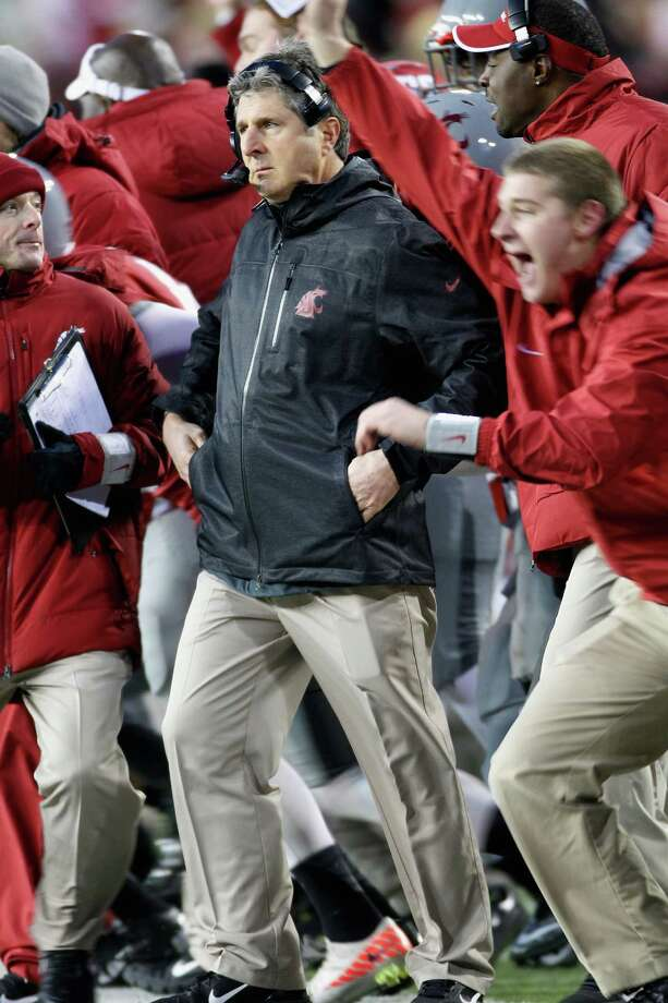 Head coach Mike Leach of the Washington State Cougars reacts as the Cougars win the Apple Cup 31-28 during overtime against the Washington Huskies. Photo: William Mancebo, Getty Images / 2012 Getty Images