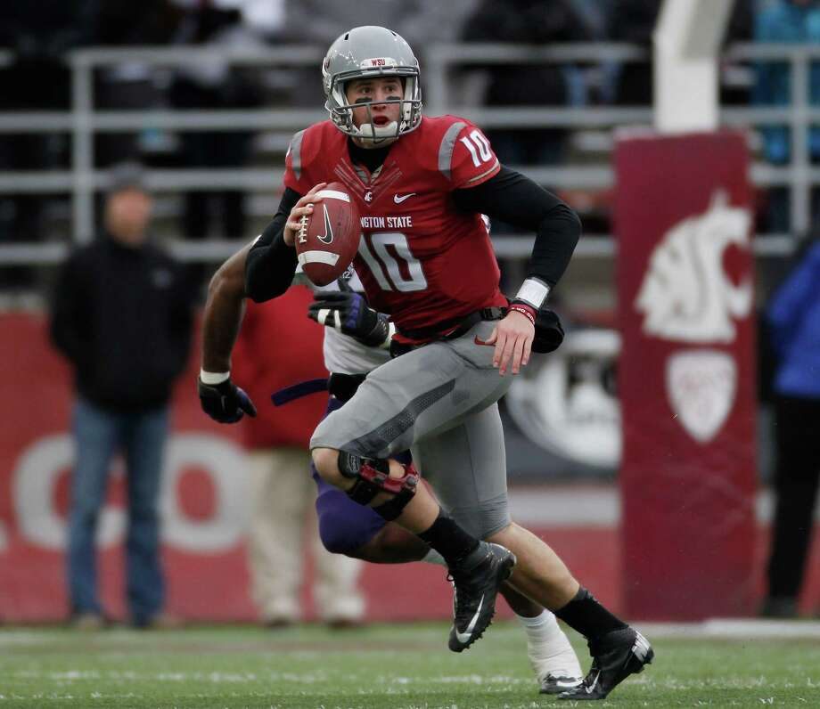 Quarterback Jeff Tuel #10 of the Washington State Cougars looks to pass during the game against the Washington Huskies. Photo: William Mancebo, Getty Images / 2012 William Mancebo