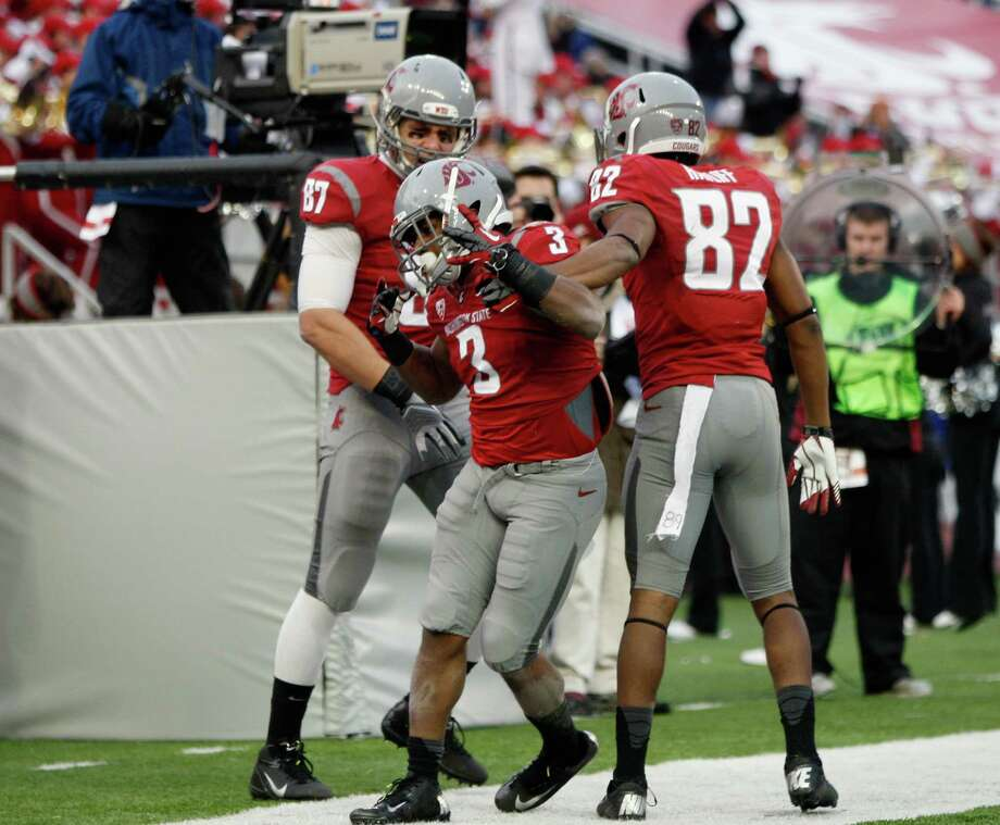 Running back Carl Winston #3 of the Washington State Cougars reacts with teammates Andrei Lintz #87 and Bobby Ratliff #82 after his fourth quarter touchdown during the game against the Washington Huskies. Photo: William Mancebo, Getty Images / 2012 Getty Images