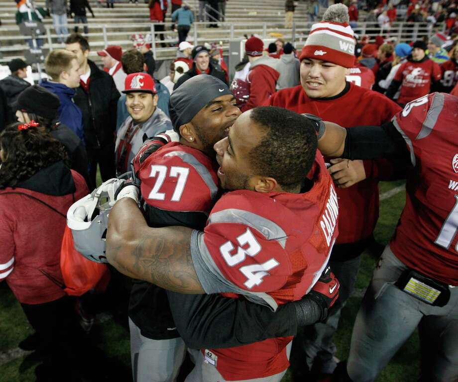 Tracy Clark #27 and Teondray Caldwell #34 celebrate as the Cougars win the Apple Cup 31-28 during overtime against the Washington Huskies. Photo: William Mancebo, Getty Images / 2012 Getty Images