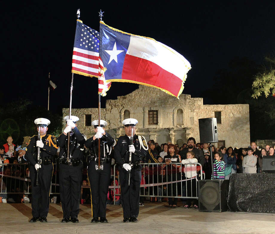 The Color Guard from Bexar County Sheriffs Department presents the U.S. and Texas flags at Alamo Plaza for the 28th Annual H-E-B Tree Lighting Ceremony on Friday, Nov. 23, 2012. The 55-foot tall fir tree was lit with 10,000 LED lights and with 450 ornaments. The event kicked off the holiday season followed by the 30th Annual Ford Holiday River Parade & Lighting Ceremony along the San Antonio River. Photo: Kin Man Hui, San Antonio Express-News / ©2012 San Antonio Express-News