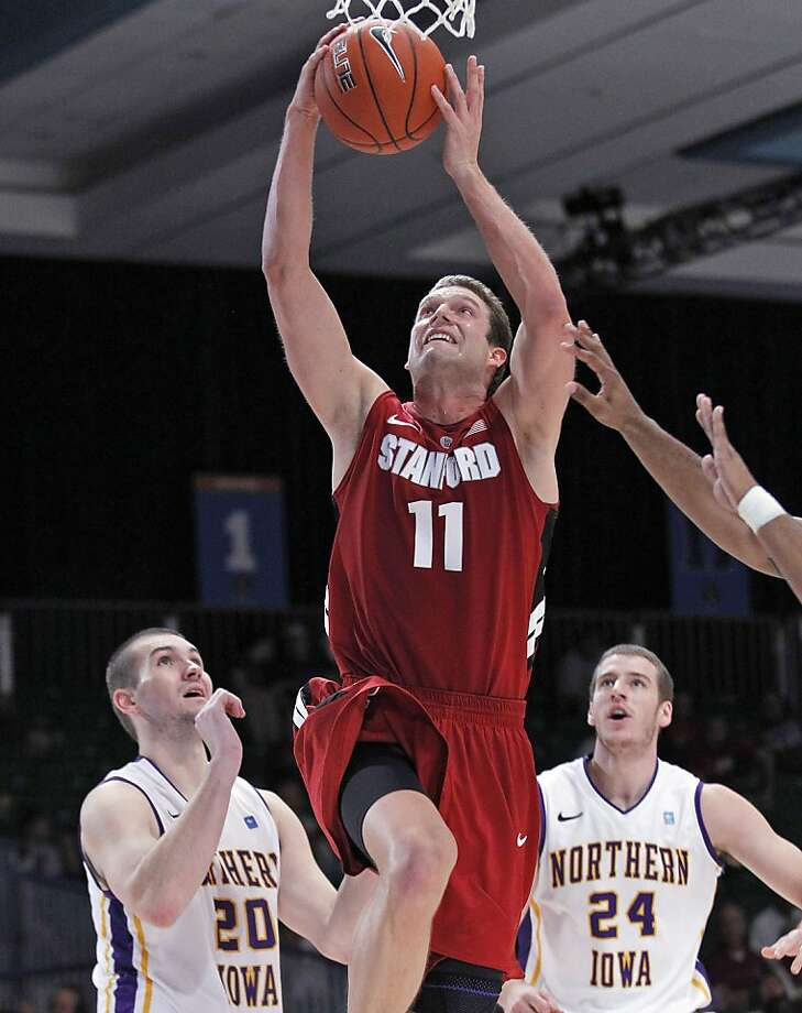 Andy Brown (11) shoots in Stanford's 66-50 victory. Photo: John Bazemore, Associated Press