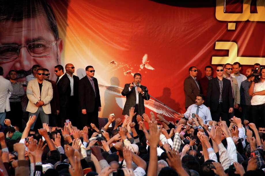 Egyptian President Mohammed Morsi speaks to supporters outside the Presidential palace in Cairo, Egypt, Friday, Nov. 23, 2012. Opponents and supporters of Mohammed Morsi clashed across Egypt on Friday, the day after the president granted himself sweeping new powers that critics fear can allow him to be a virtual dictator. (AP Photo/Aly Hazaza, El Shorouk) Photo: Aly Hazzaa