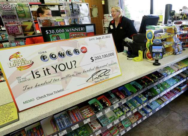 File - in this Sept. 27, 2012 file photo, a Powerball promotional check sits on the counter in the Casey's General Store, in Bondurant, Iowa. The jackpot for Powerball's Saturday, Nov. 24, 2012, drawing has climbed to $325 million, the fourth-largest in the game's history. (AP Photo/Charlie Neibergall, File) Photo: Charlie Neibergall