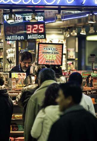 People wait in line to purchase lottery on Friday, Nov. 23, 2012 in New York.  The jackpot for Powerball's weekend drawing has climbed to $325 million, the fourth-largest in the game's history.  Powerball organizers say this is the first run-up to a large jackpot that's fallen over a major holiday.  (AP Photo/Bebeto Matthews) Photo: Bebeto Matthews