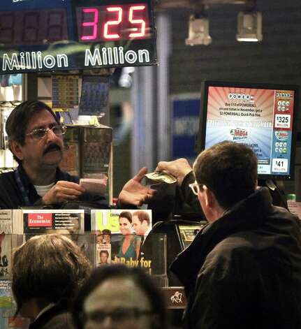 A vendor, left, receives money for a lottery  purchase on Friday, Nov. 23, 2012 in New York.  The jackpot for Powerball's weekend drawing has climbed to $325 million, the fourth-largest in the game's history.  Powerball organizers say this is the first run-up to a large jackpot that's fallen over a major holiday.  (AP Photo/Bebeto Matthews) Photo: Bebeto Matthews