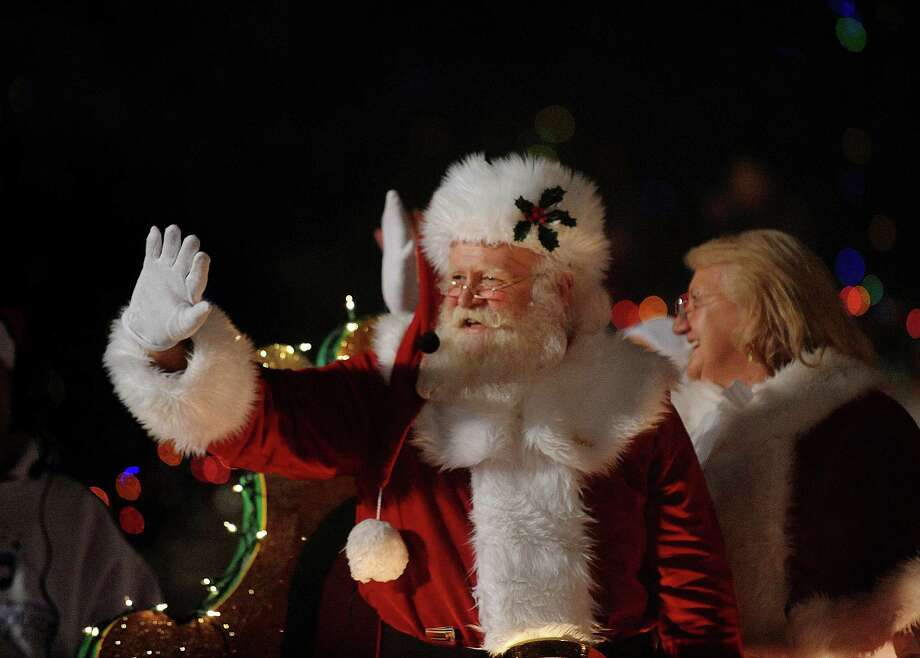 Santa Claus himself waves as he rides on a float during the 30th annual Ford Holiday River Parade  & Lighting Ceremony on the River Walk in downtown San Antonio on Friday, Nov. 23, 2012. Photo: Billy Calzada, San Antonio Express-News / SAN ANTONIO EXPRESS-NEWS