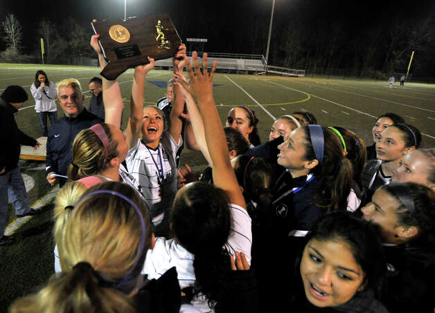 The Immaculate High School girls soccer team celebrates its Class S state championship win over Portland at Municipal Stadium in Waterbury on Friday, Nov. 23, 2012. Immaculate won, 5-0. Photo: Jason Rearick / The News-Times